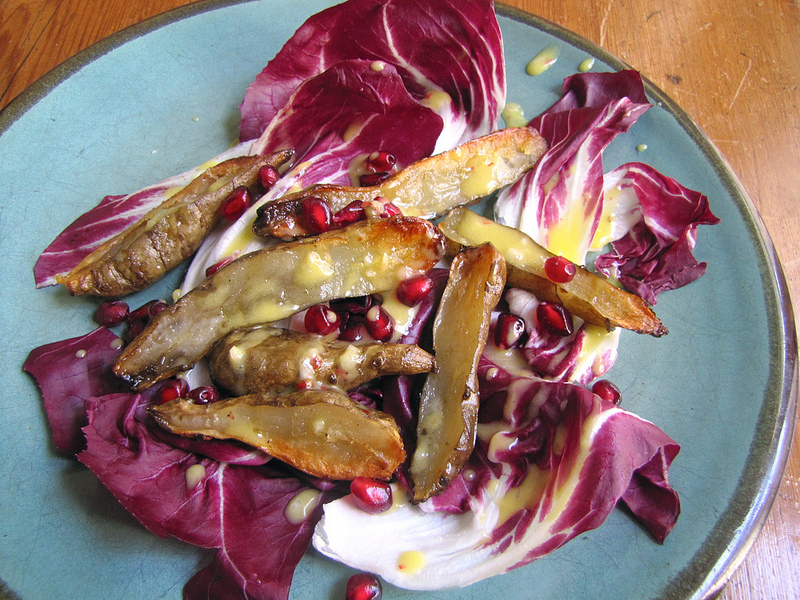 Sunchokes with Radicchio, Pomegranate Seeds & Pink Peppercorn Dressing