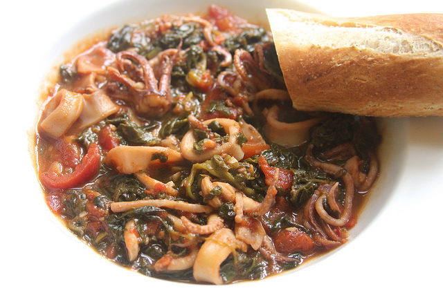 Calamari Braised with White Wine, Tomatoes & Spinach