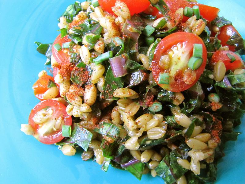 Smoked Paprika Freekeh Salad with Kale, Tomatoes & Garlic Scapes