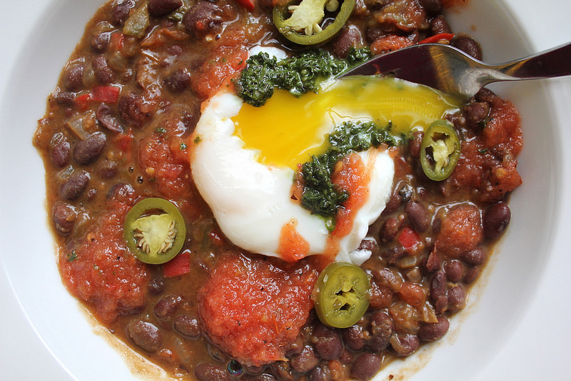Black Beans with Salsa Roja, Kale Salsa Verde, and a Poached Egg